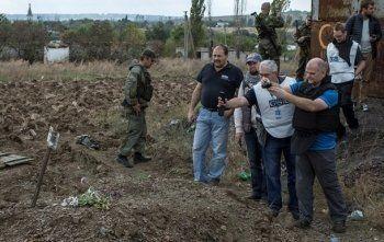 Эксперты ОБСЕ подтвердили обнаружение сотен неопознанных тел в массовых захоронениях под Донецком